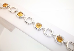 Sterling silver bracelet with square citrine stones up for auction.