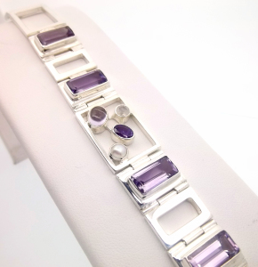 Sterling silver bracelet with amethyst stones up for auction.