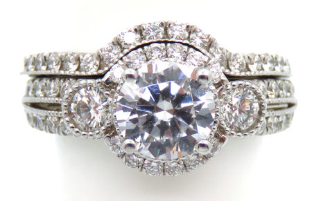 14kw enagagement and wedding band. Engagement has 36 round diamonds = .53ct and 2 rounds =.27ct Matching band has 20 rounds =.31cttw