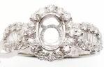 18kt white gold and .92ctw diamonds semi-mount. Center will accommodate a 7x5mm oval stone.