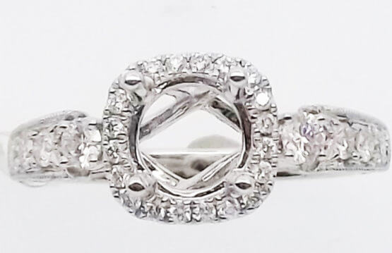 14kt white gold .55ctw diamonds semi-mount. Center will accommodate a 1.0ct or larger stone.