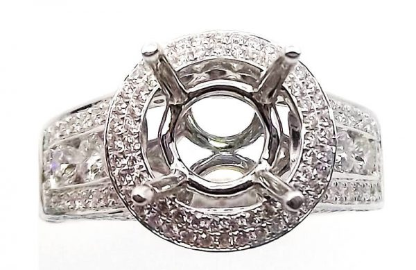 18kt white gold and 1.50ctw diamonds semi-mount. Center will accommodate a 1.5ct or larger stone.