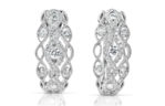 14kt white gold with .72ctw diamond huggie earrings