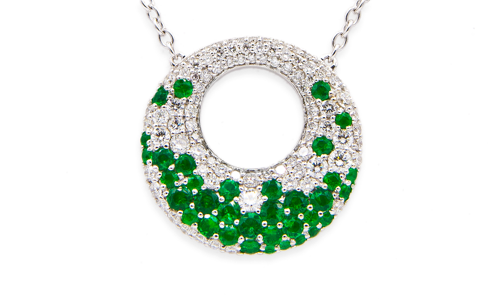 14kt white gold emerald and diamond pendant with .86ctw diamonds and 1.03ctw emeralds.